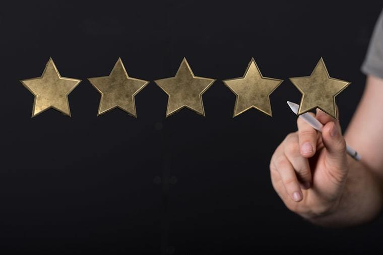 Testimonial advertising review stars on a black background