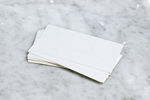 Small white pieces of paper on marble